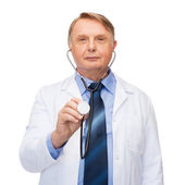 Smiling doctor or professor with stethoscope — Stockfoto