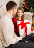 Smiling father and daughter looking at each other — Stock Photo