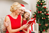 Smiling family reading book — Stock Photo