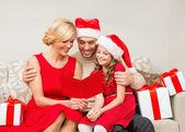 Smiling family reading postcard — Stock Photo