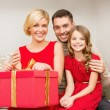 Happy family opening gift box — Stock Photo
