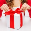 Woman hands opening gift boxes — Stock Photo