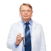 Smiling doctor or professor with stethoscope — Stok fotoğraf