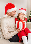 Smiling daughter waiting for a present from father — Stock Photo