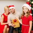 Smiling family decorating christmas tree — Lizenzfreies Foto