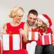 Happy family opening gift boxes — Stok fotoğraf
