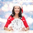 Stock Photo: Womin santhelper hat with clock showing 12