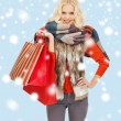 Teenage girl in winter clothes with shopping bags — Stock Photo #35430705