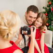 Stock Photo: Mother taking picture of father and daughter