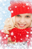 Teenage girl in red hat and scarf — Stock Photo