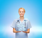 Smiling female doctor or nurse with tablet pc — Foto de Stock