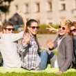 Group of students or teenagers waving hands — Stock Photo