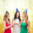 Three women wearing hats with champagne glasses — Stock fotografie #35682871