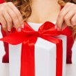 Woman hands opening gift boxes — Stock Photo #35682951