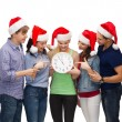 Group of smiling students with clock showing 12 — Stock Photo #35683069