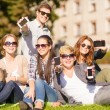 Students showing smartphones — Stock Photo #35683287