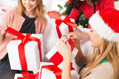 Three women holding many gift boxes — Stockfoto