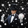 Magician showing trick with playing cards — ストック写真