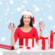 Woman in santa helper hat with many gift boxes — Stok fotoğraf