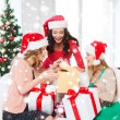 Women in santa helper hats with many gift boxes — Stockfoto #35797033