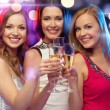 Three smiling women with champagne glasses — Stock Photo #35797379