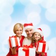 Smiling family giving many gift boxes — Stock Photo #35798829