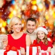 Smiling family holding many gift boxes — Stock Photo #35798999