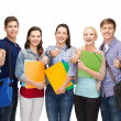 Group of smiling students showing thumbs up — Stock Photo