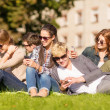Students looking at smartphones and tablet pc — Stock Photo