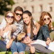 Group of students or teenagers showing thumbs up — Stock Photo #35838055