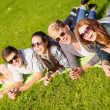 Group of students or teenagers hanging out — Stock Photo #35844559