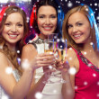 Three smiling women with champagne glasses — Stok fotoğraf #35897095