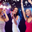 Three smiling women dancing in the club — Stock Photo #35897113