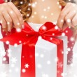 Womhands opening gift boxes — Stock Photo #35897309