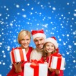 Smiling family giving many gift boxes — Foto de Stock