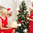 Smiling family decorating christmas tree — Stock Photo #35897425