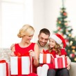 Happy family opening gift boxes — Foto de Stock
