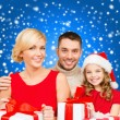 Smiling family holding many gift boxes — Stock Photo #35897459