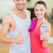 Two smiling people in the gym — Stock Photo #35897893