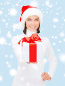Woman in santa helper hat holding gift box — Stock fotografie