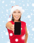 Smiling woman in santa helper hat with smartphone — Stock fotografie