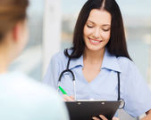 Smiling doctor or nurse with patient — Foto Stock