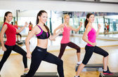 Group of smiling people doing aerobics — Stock Photo