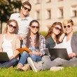 Students or teenagers with laptop computers — Stock Photo #35901023