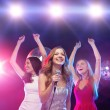 Three smiling women dancing in the club — Stok fotoğraf