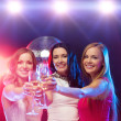 Three smiling women with champagne glasses — Стоковая фотография