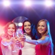 Three smiling women with champagne glasses — Foto de Stock