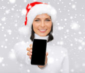 Smiling woman in santa helper hat with smartphone — Stock Photo