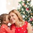 Stock Photo: Mother and daughter whispering gossip
