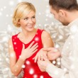 Romantic man proposing to a woman in red dress — Stock Photo